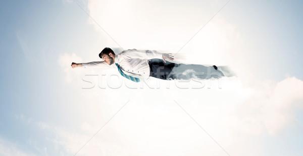 Zakenman vliegen zoals wolken hemel Stockfoto © ra2studio