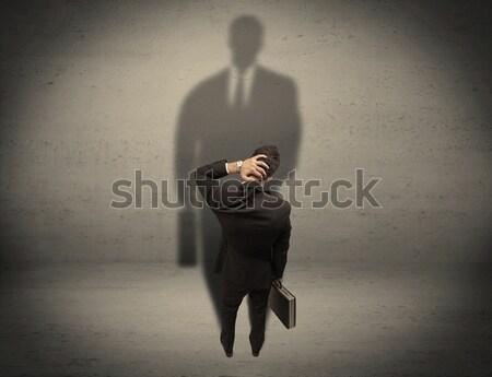 Zakenman naar groot schaduw jonge beginner Stockfoto © ra2studio