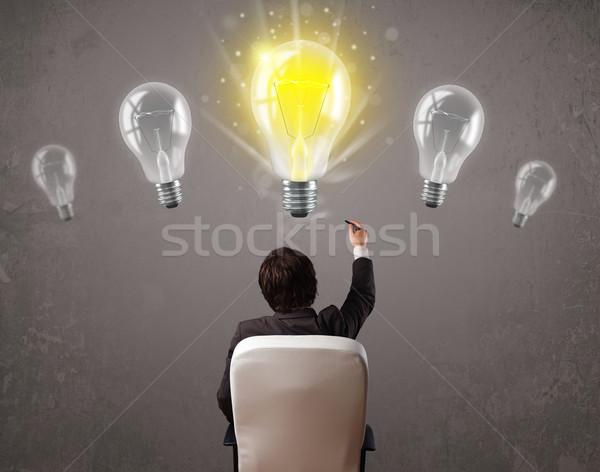 ストックフォト: 事業者 · アイデア · 電球 · 明るい · 手 · 背景