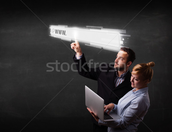 Young business couple touching web browser address bar with www  Stock photo © ra2studio