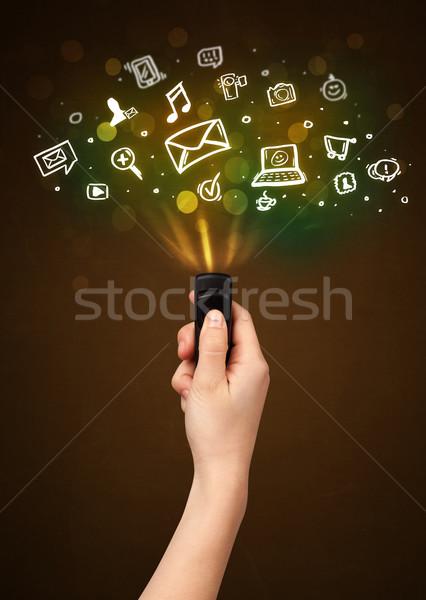 Mão controle remoto ícones fora Foto stock © ra2studio