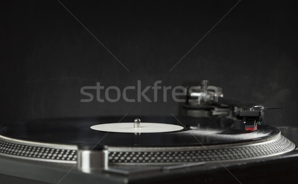 Turntable playing vinyl close up with needle on the record  Stock photo © ra2studio