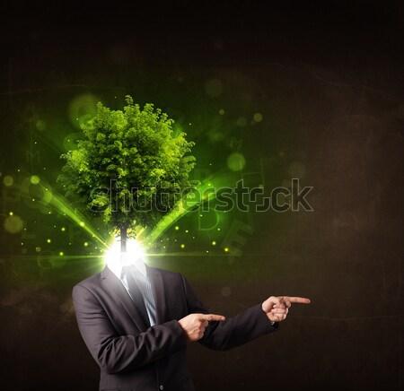 Man with green tree head concept Stock photo © ra2studio
