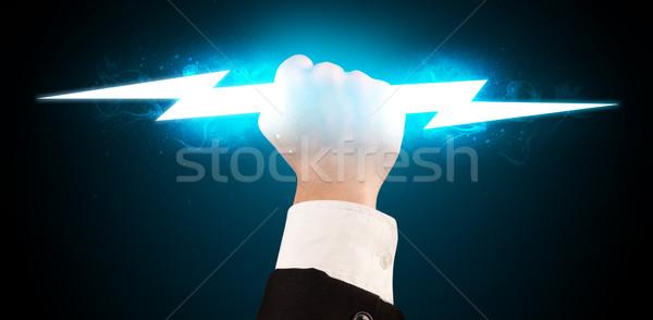 üzletember tart izzó villám kezek tűz Stock fotó © ra2studio