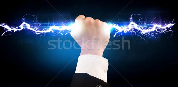 Geschäftsmann halten Strom Licht Bolzen Hände Stock foto © ra2studio