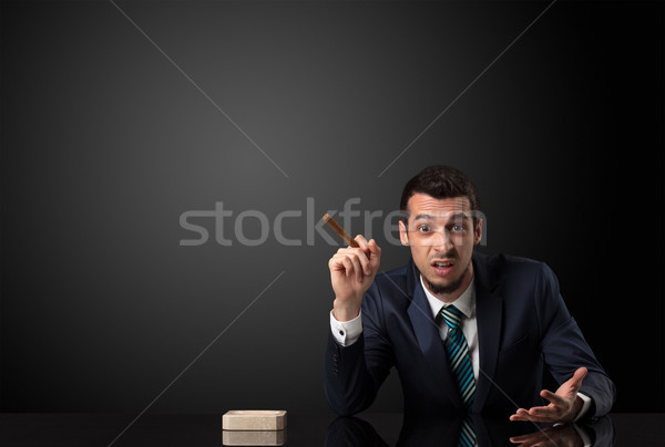 Businessman holding cigarette. Stock photo © ra2studio