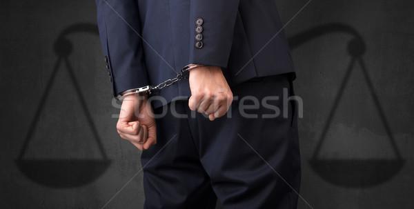 Tutuklandı adam dengelemek işadamı kelepçe eller Stok fotoğraf © ra2studio