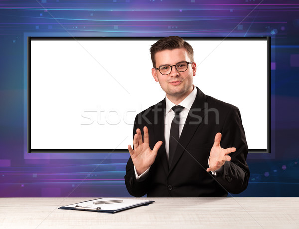 Television program host with big copy screen in his back Stock photo © ra2studio
