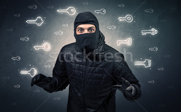 Burglar holding tool. Stock photo © ra2studio