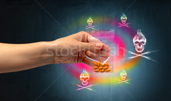 Stock photo: Deliver illegal capsules with skull concept