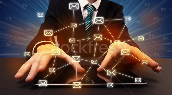 Stock photo: Typing with connected communication icons around