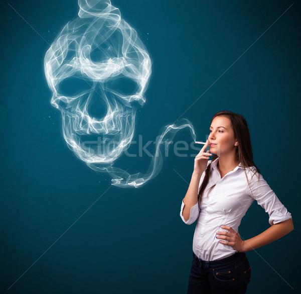 若い女性 喫煙 たばこ 毒性 頭蓋骨 ストックフォト © ra2studio