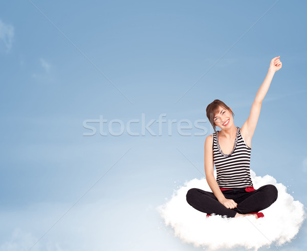 Young woman sitting on cloud with copy space Stock photo © ra2studio