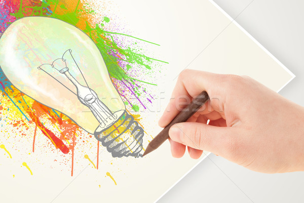 Hand drawing on paper a colorful splatter lightbulb  Stock photo © ra2studio