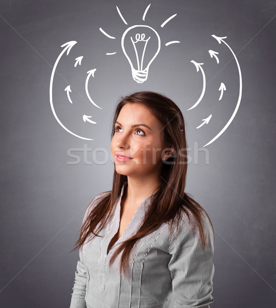 Pretty lady thinking with arrows and light bulb overhead Stock photo © ra2studio