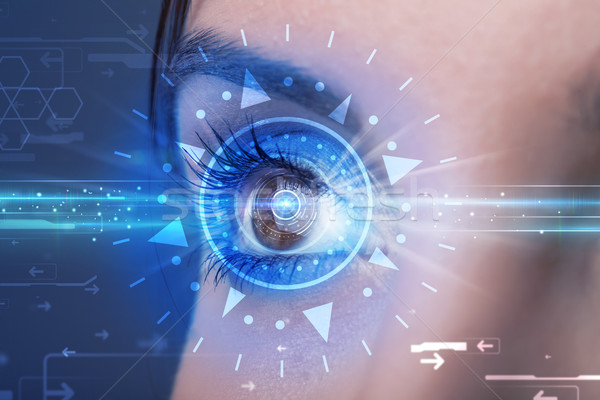 Cyber girl with technolgy eye looking into blue iris Stock photo © ra2studio