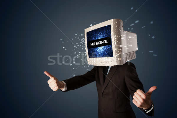 Man with a monitor head, no signal sign on the display Stock photo © ra2studio