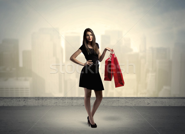 City woman standing with shopping bags Stock photo © ra2studio