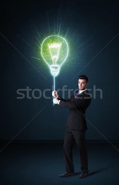 Zakenman idee lamp houden Blauw Stockfoto © ra2studio