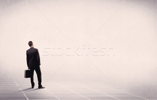 Business person standing in empty space Stock photo © ra2studio