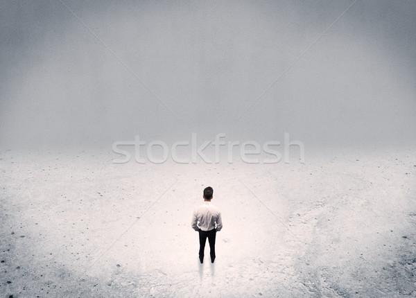 Businessman standing in urban empty space Stock photo © ra2studio