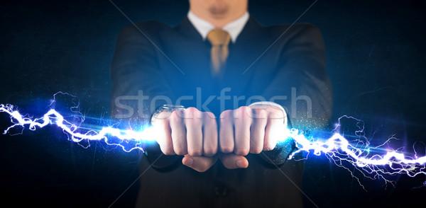 Homem de negócios eletricidade luz parafuso mãos Foto stock © ra2studio
