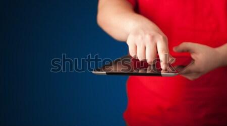 Közelkép kéz tart digitális touchpad tabletta Stock fotó © ra2studio