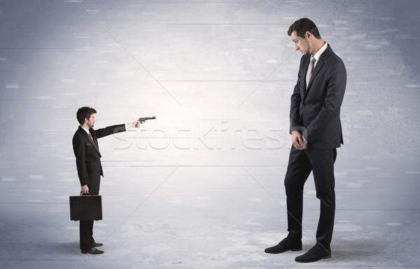 Kicsi üzletember lövöldözés óriás pici fegyver Stock fotó © ra2studio