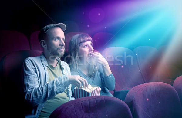 Teenager couple watching movie  Stock photo © ra2studio