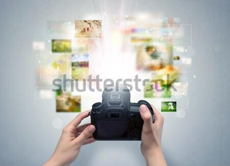 Hand taking photo with glowing flash concept Stock photo © ra2studio