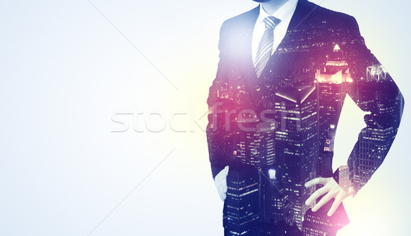 Young man thinking with city wallpaper Stock photo © ra2studio