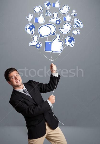 Stock fotó: Vonzó · férfi · tart · társasági · ikon · léggömb
