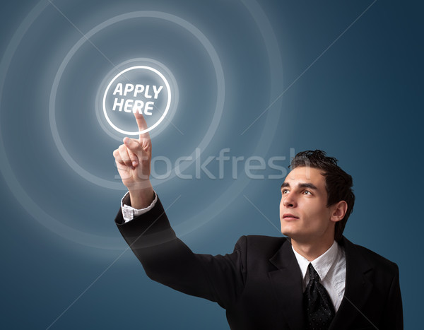 man pressing a touchscreen button Stock photo © ra2studio