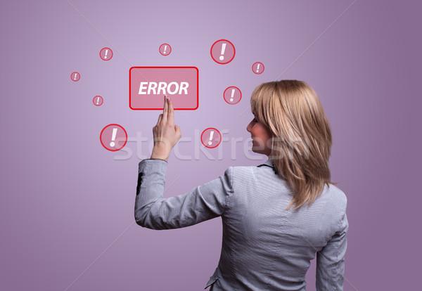 hand pressing ERROR button Stock photo © ra2studio