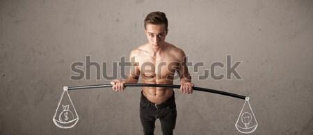 Muskularny człowiek zrównoważony silne siłowni wykonywania Zdjęcia stock © ra2studio