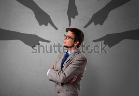 Young man with devil horns and wings drawing Stock photo © ra2studio