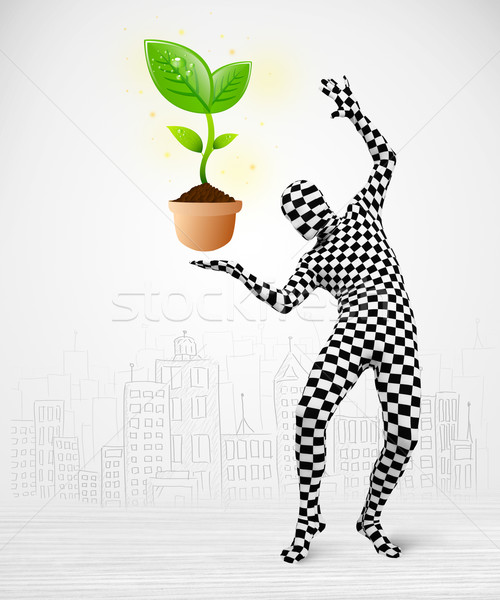man in full body suit with eco plant Stock photo © ra2studio