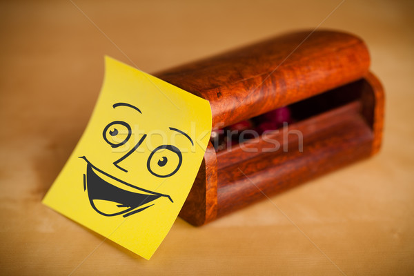 Post-it note with smiley face sticked on a jewelry box Stock photo © ra2studio