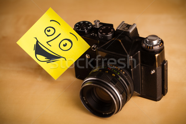 Post-it note with smiley face sticked on photo camera Stock photo © ra2studio