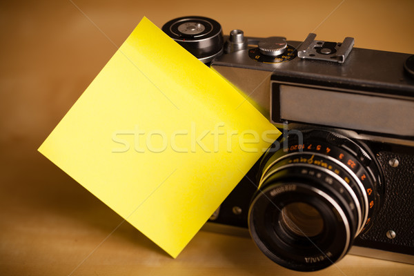 Empty post-it note sticked on photo camera Stock photo © ra2studio