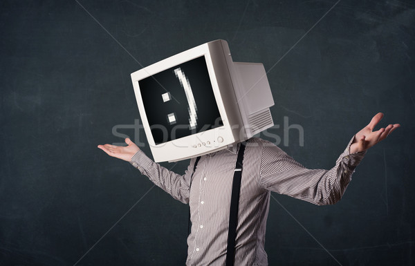 Funny young businessman with a monitor on his head and smiley on Stock photo © ra2studio