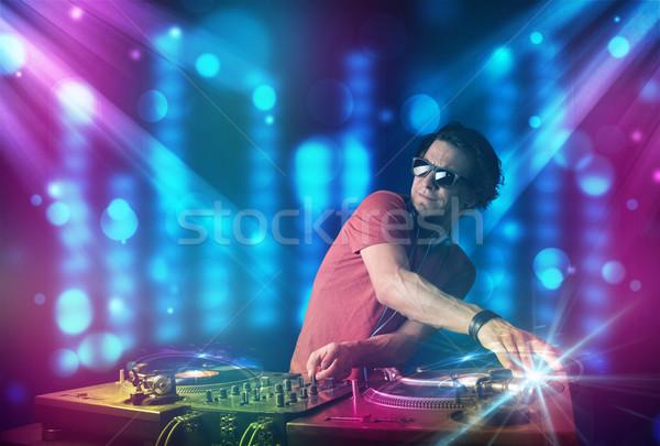Muzyki klub niebieski fioletowy światła młodych Zdjęcia stock © ra2studio
