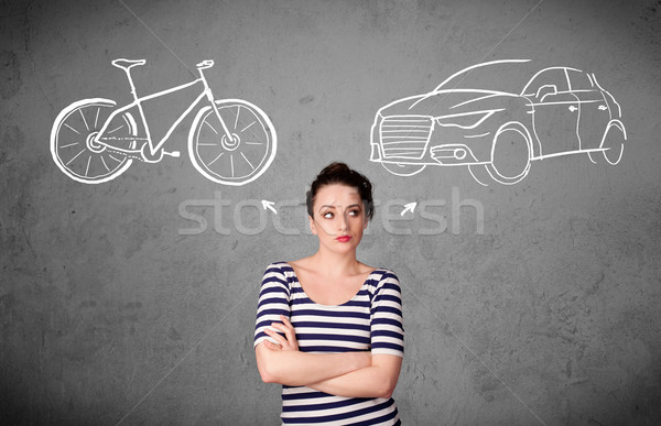 Woman making a choice between bicycle and car Stock photo © ra2studio