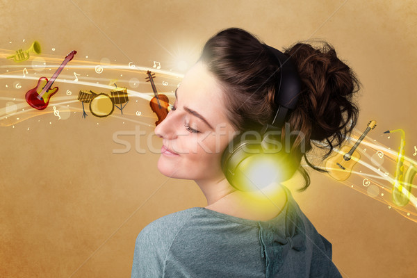 Stock photo: Young woman with headphones listening to music