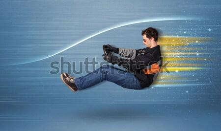 Moço condução imaginário rápido carro turva Foto stock © ra2studio