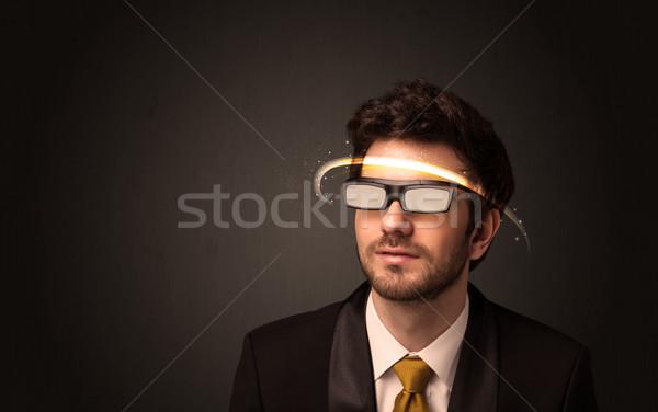 Jóképű férfi néz futurisztikus magas tech szemüveg Stock fotó © ra2studio