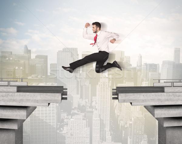 Enérgico homem de negócios saltando ponte lacuna trabalhar Foto stock © ra2studio