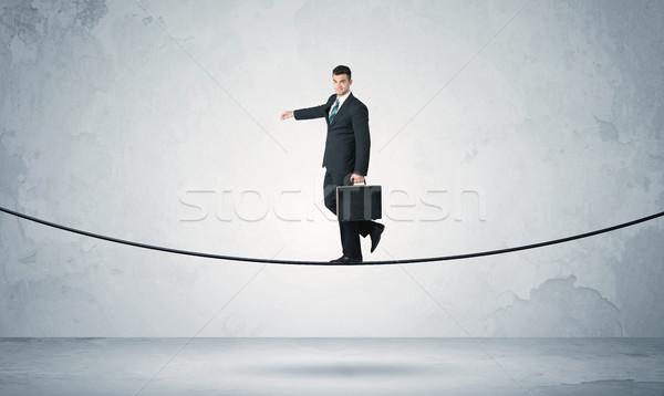 Satış adam dengeleme sıkı halat işadamı Stok fotoğraf © ra2studio