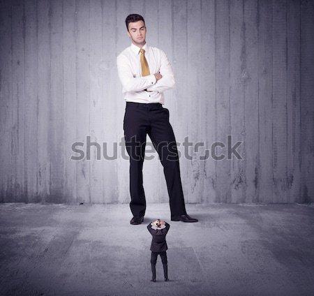 Huge boss lokking at small business man Stock photo © ra2studio