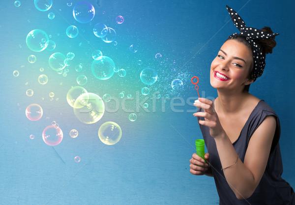 Stock fotó: Csinos · hölgy · fúj · színes · buborékok · kék